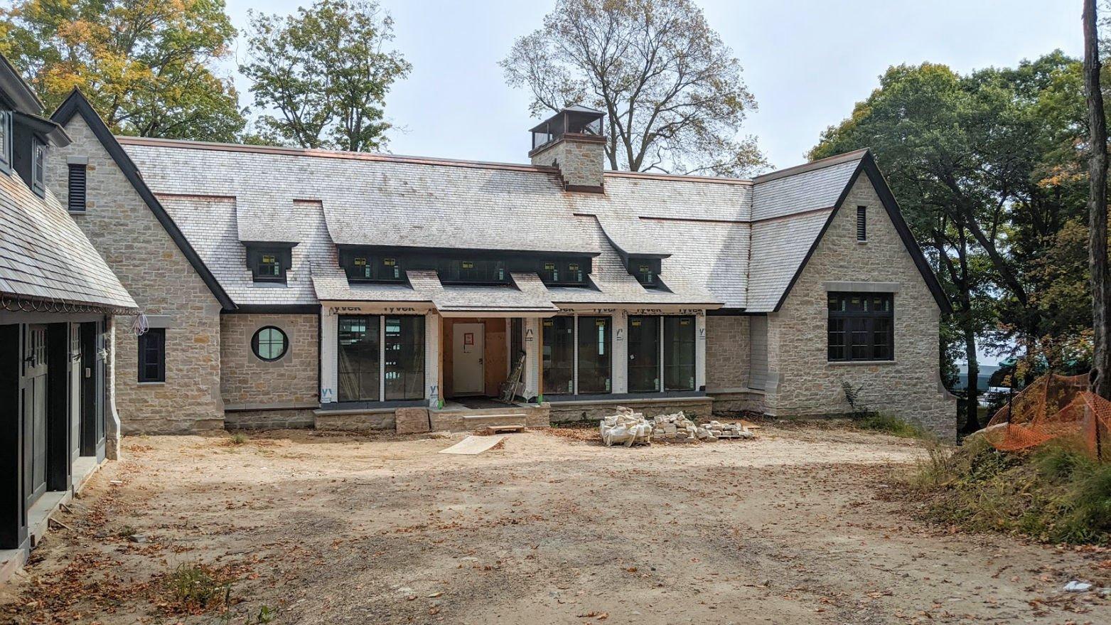 Lakeside stone cottage under construction