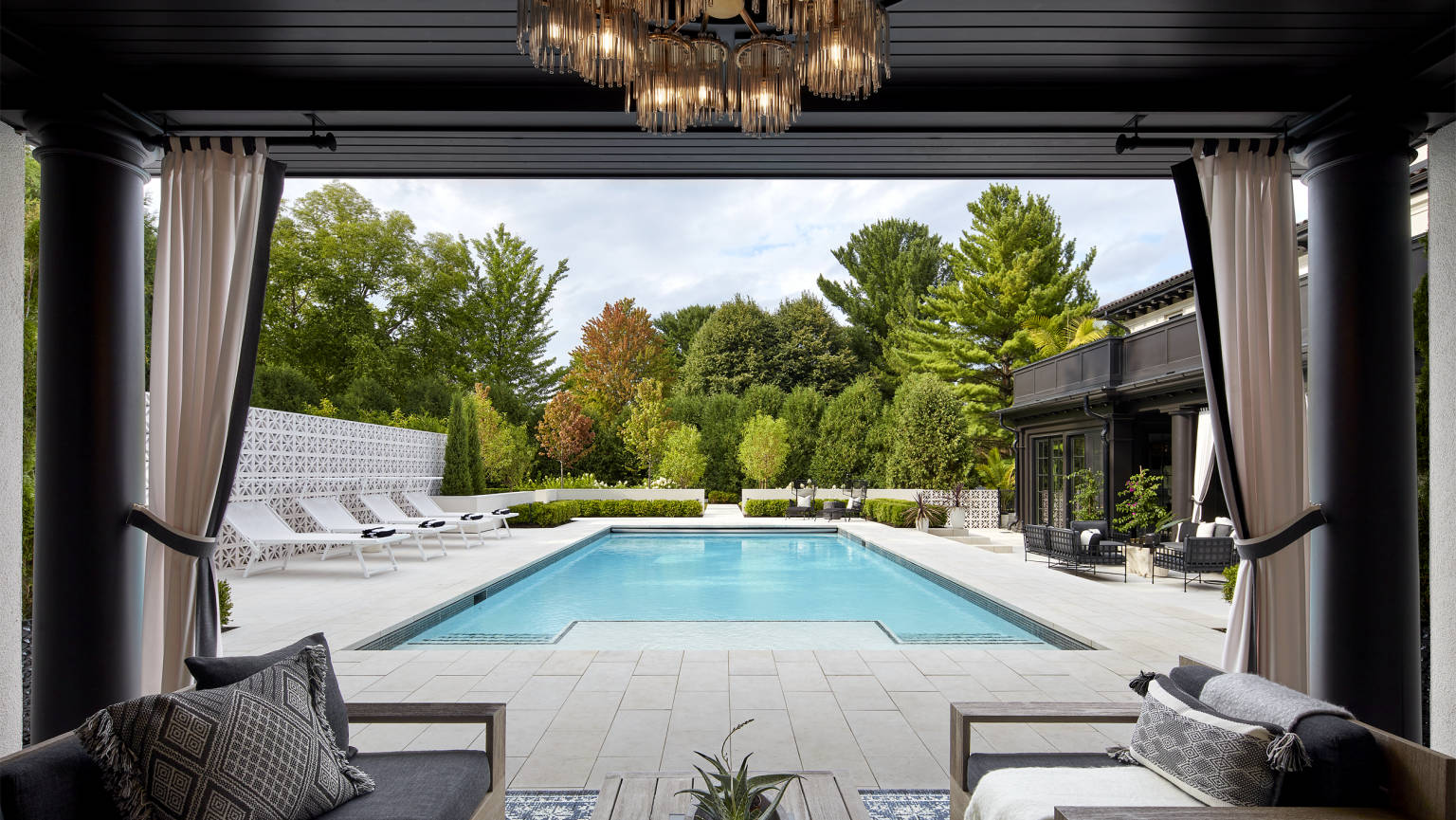cabana view of pool by Charlie and Co. Design