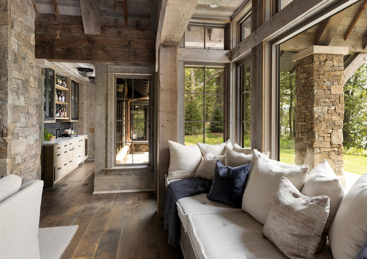 sunroom in Rustic Western Lodge by Charlie & Co Design